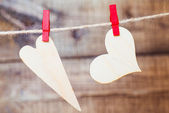 Two hearts hanging on a rope with pins — Stock Photo
