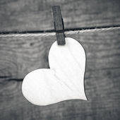 Heart hanging on a rope with pins — Stock Photo