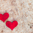 Stock Photo: Two red hearts on sand