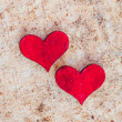 Two red hearts on sand — Stock Photo
