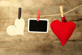 Blank instant photo and heart hanging on the clothesline — Stock Photo