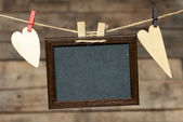Blackboard with heart on rope — Stockfoto