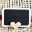 Stock Photo: Heart on smal blackboard