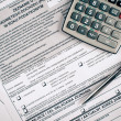 A calculator, pen, and financial statement — Stock Photo