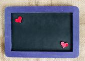 Heart on small blackboard — Stock Photo