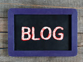 Blog word handwritten on the black chalkboard. — Stock Photo