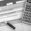 Stock Photo: Modern calculator, black pen and tax forms