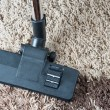 Stock Photo: Vacuum cleaner to tidy up
