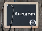 Blackboard with word Aneurism and stethoscope — Foto Stock