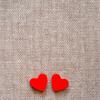 Stock Photo: Hearts on hessian