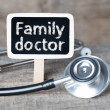 Blackboard with word Family doctor and stethoscope — Stock Photo