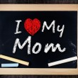 I love my mom phrase handwritten on the school blackboard — Stock Photo #39650133