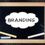 Branding handwritten with white chalk on a blackboard — Stock Photo #39652173