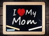 I love my mom phrase handwritten on the school blackboard — Stock Photo