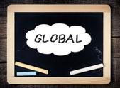 Global Concept inside cloud on blackboard — Stock Photo