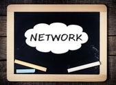 Network Concept inside cloud on blackboard — Stock Photo