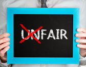 Unfair-fair — Stock Photo