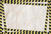 Paper with danger tape border — Stock Photo