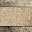 Burlap texture on wooden table — Stock Photo
