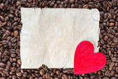 Coffee Beans with Heart on Paper Sheet — Stock Photo
