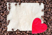 Coffee Beans with Heart on Paper Sheet — Stock fotografie