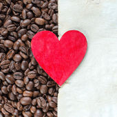 Heart on Roasted Coffee Beans and Paper Sheet — Fotografia Stock