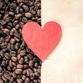 Heart on Roasted Coffee Beans and Paper Sheet — Stockfoto