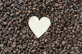 Wooden heart on coffee — Stock Photo