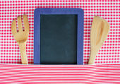 Menu blackboard with wooden spoon and fork — Stock Photo