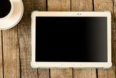 Digital tablet and coffee cup — Foto de Stock