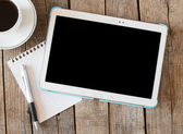 Empty tablet pc and a coffee and notebook with pen — Stock Photo