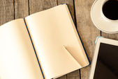 Empty tablet pc and a coffee and notebook with pen — Foto de Stock