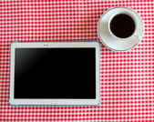 Digital tablet and coffee cup — Foto de Stock