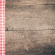 Old wooden board with checkered cloth — Stock Photo #42779663