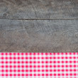 Old wooden board with checkered cloth — Stock Photo