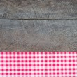 Old wooden board with checkered cloth — Stock Photo #42780873