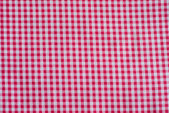 Red classic checkered tablecloth texture — Stock Photo