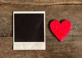 Photo frame and small red heart — Zdjęcie stockowe