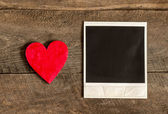 Photo frame and small red heart — Photo