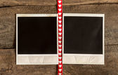 Two photo frames and small red  heart ribbon — Foto Stock