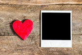 Photo frame and small red heart — Stock Photo