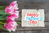 Tulips and paper with text Happy Father's Day — 图库照片