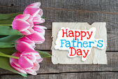 Tulips and paper with text Happy Father's Day — Stockfoto