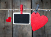Blank instant photo and small red paper hearts — Stockfoto