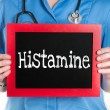 Doctor shows information on blackboard: histamine — Stock Photo #43646869