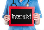 Internist on blackboard — Stock Photo