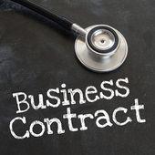 Contrato estetoscópio e negócios — Fotografia Stock