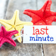 Star fish and card with text last minute — Stockfoto