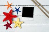Photo and starfishes — Stock Photo