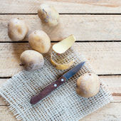 Potatoes and knife — Stock Photo